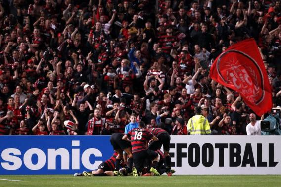 Western Sydney Wanderers player Cole is surrounded by teammates as they celebrate after he scored a goal during the Asian Champions League soccer semi-final game against FC Seoul at Parramatta Stadium
